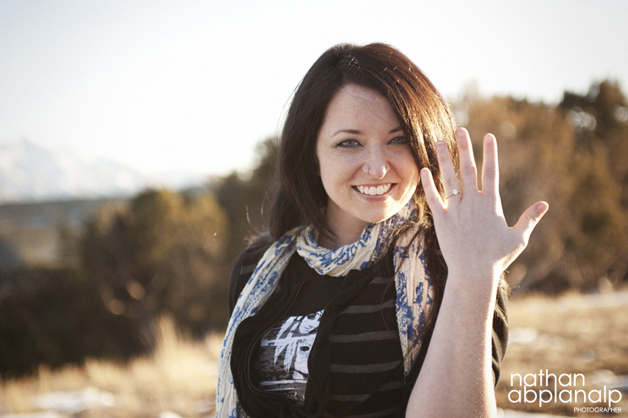 Woman showing off engagement ring in Aspen, CO