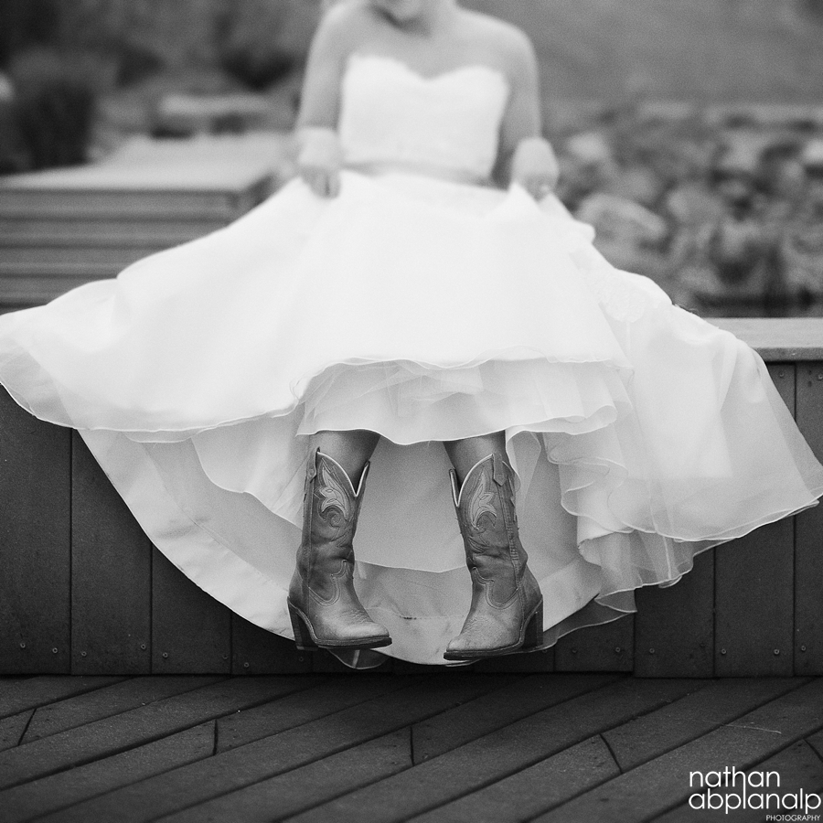 Bride in cowboy boots at the Arbor Events
