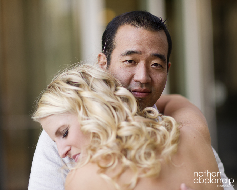 Interracial couple embracing during an uptown engagement shoot in charlotte nc