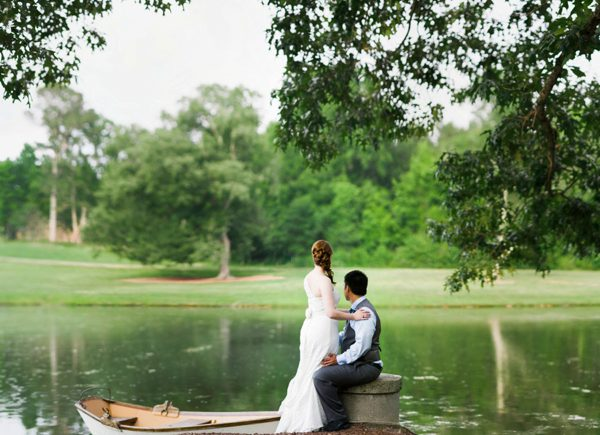 Bride and Groom by a lake at the Oaks at Salem in Apex NC