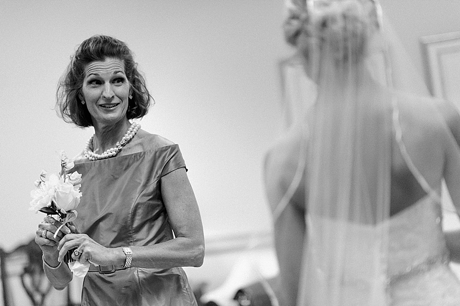 Mother glances at bride at Myers Park United Methodist Church in Charlotte NC