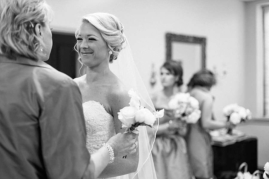 Bride smiling with mother at Myers Park United Methodist Church in Charlotte NC