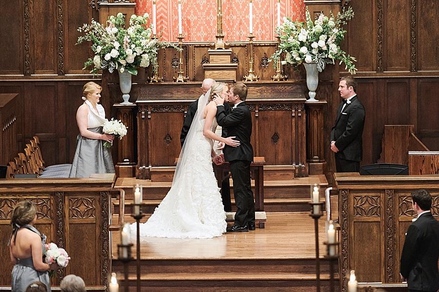 Bride and Groom share a first kiss at Myers Park United Methodist Church in Charlotte NC