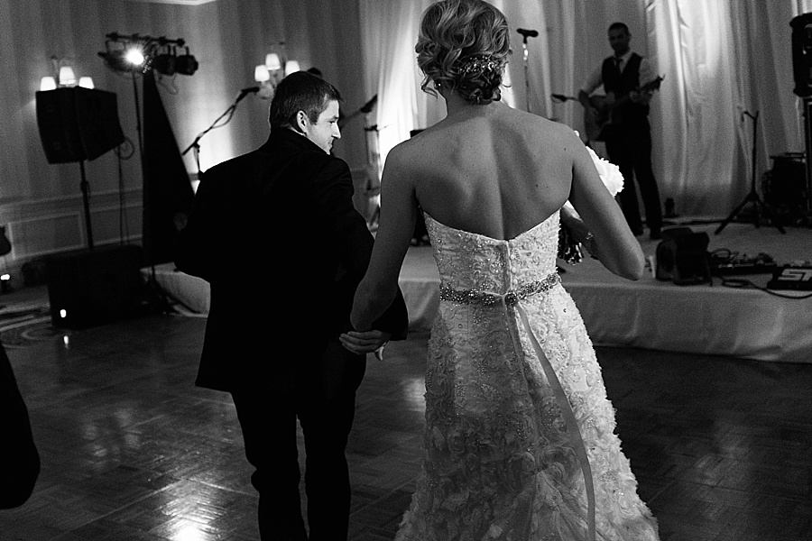 Bride and groom enter reception at the Carmel Country Club in Charlotte NC