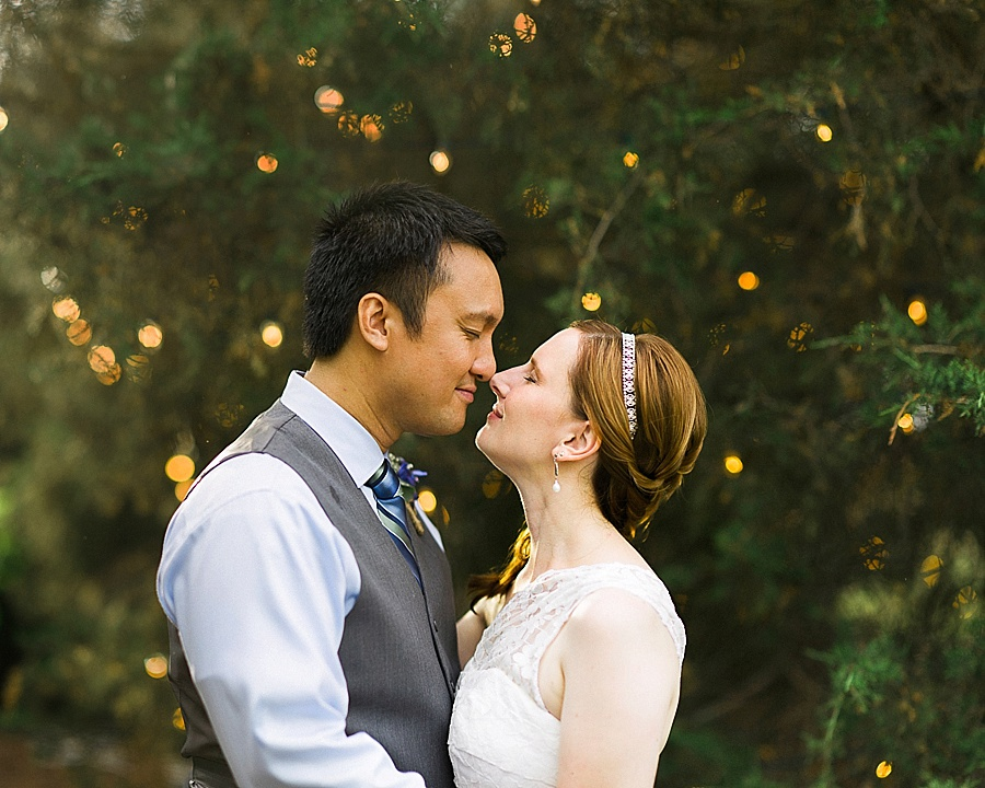 Bride and Groom kiss at the Oaks at Salem in Apex NC