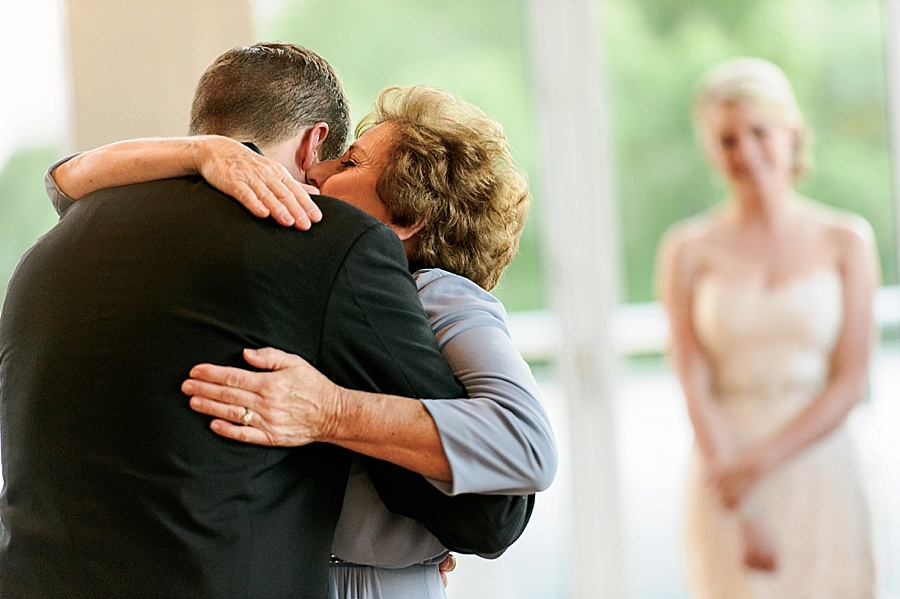 Groom and mother embrace at Foundation for the Carolinas in Charlotte NC