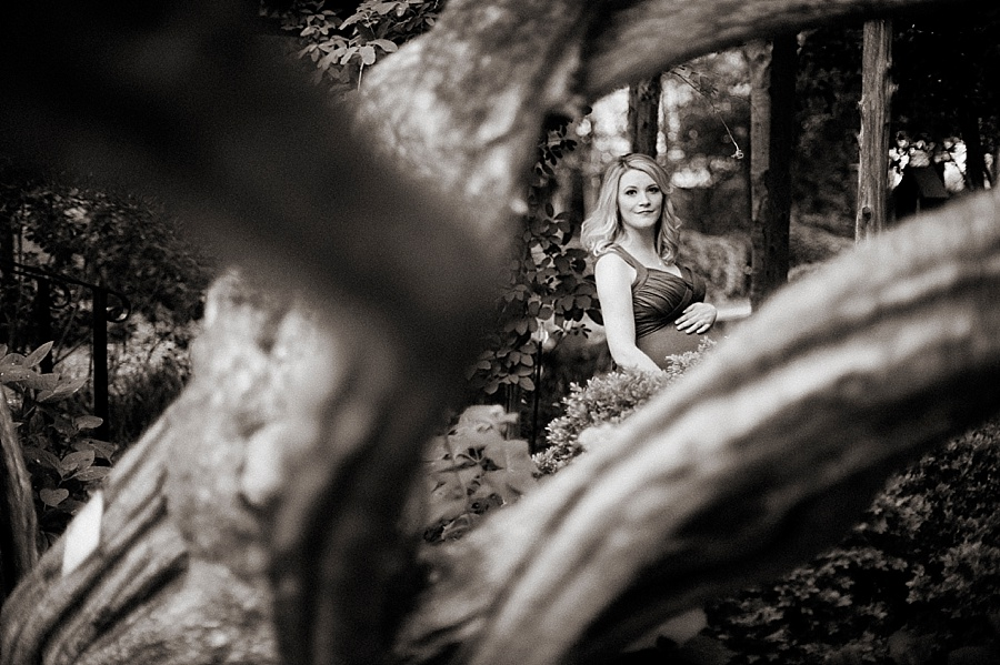 Mother poses for Maternity Session at Wing Haven Gardens in Charlotte