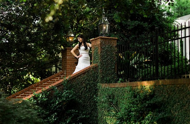 Bride on brick stairs of the Duke Mansion in Charlotte NC