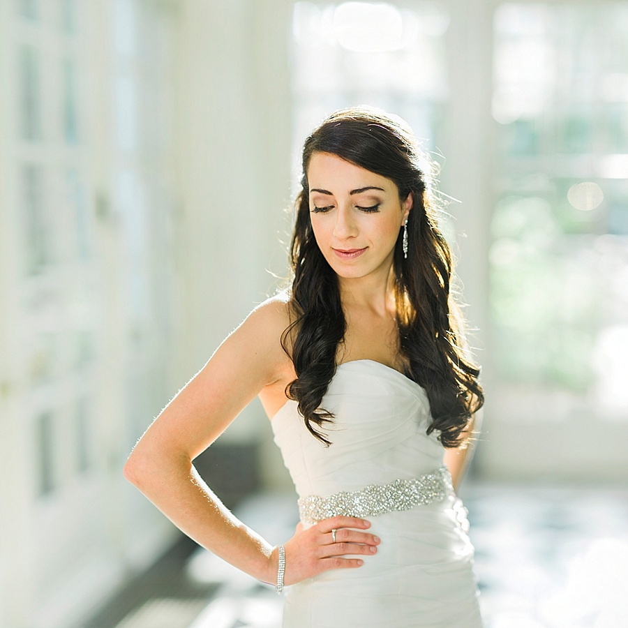 Bride with hands on hips at the Duke Mansion in Charlotte NC