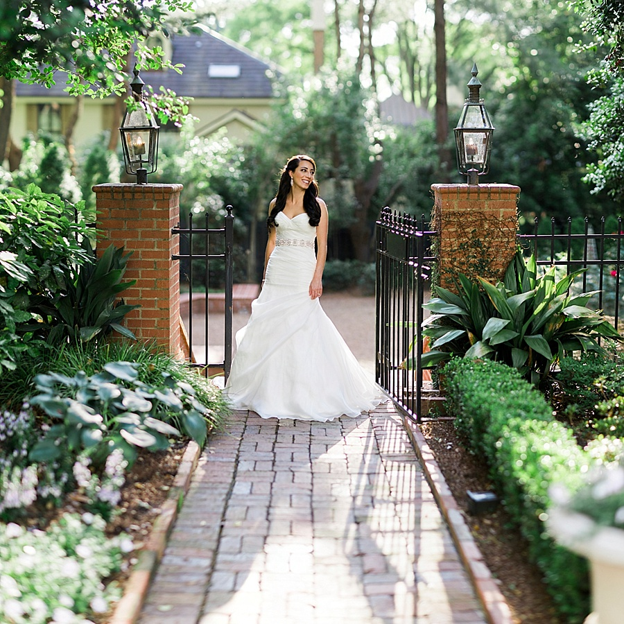 Bride posing on walk way of the Duke Mansion in Charlotte NC