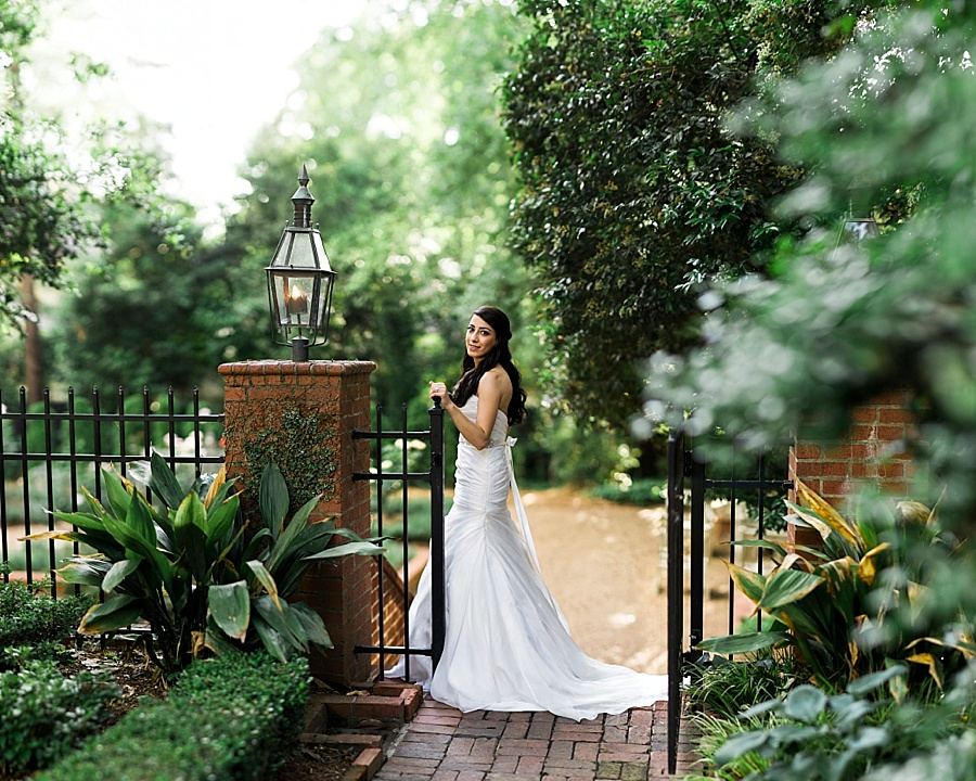 Bride standing at gate at the Duke Mansion in Charlotte NC