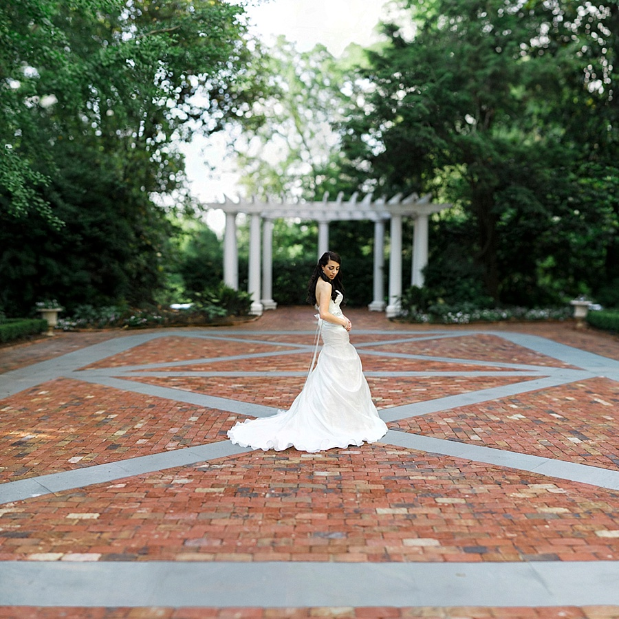 Bride in the court yard at the Duke Mansion in Charlotte NC