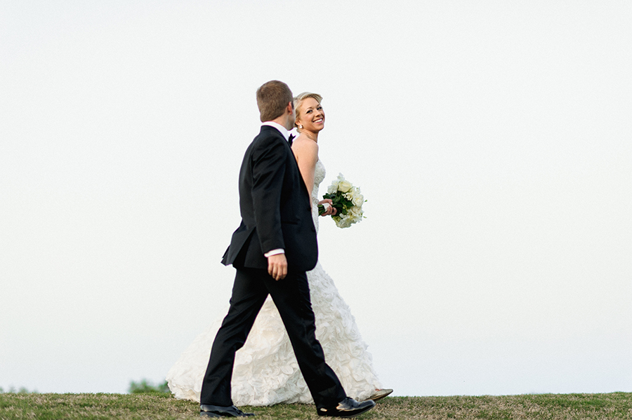 Bride and Groom walking on hilltop at the Carmel Country Club in Charlotte NC