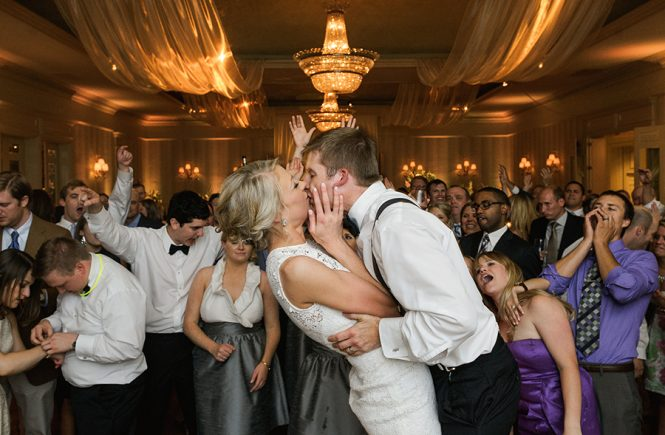 Groom kissing bride while dancing at the Carmel Country Club in Charlotte NC