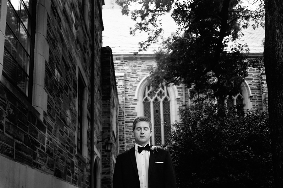 Groom stands outside the Myers Park Methodist Church