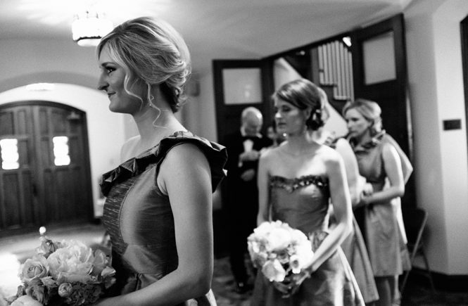 Bridesmaids look on at the Bride at the Carmel Country Club in Charlotte NC