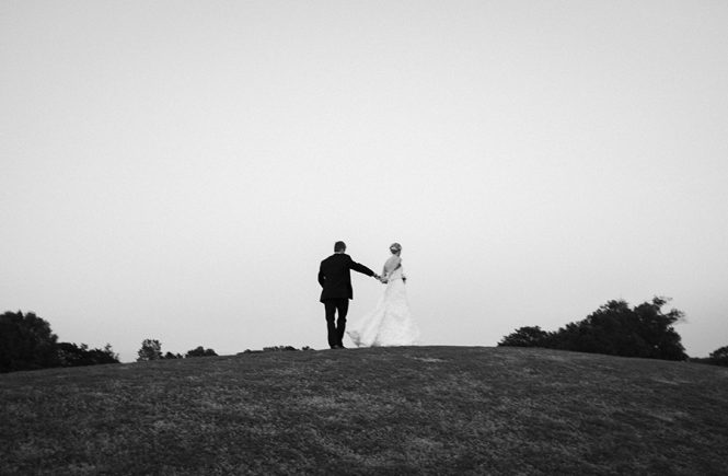 B&W couple walking on the green at the Carmel Country Club in Charlotte NC
