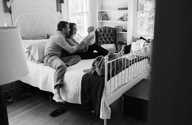 Mother and Father with baby on bed in Charlotte NC