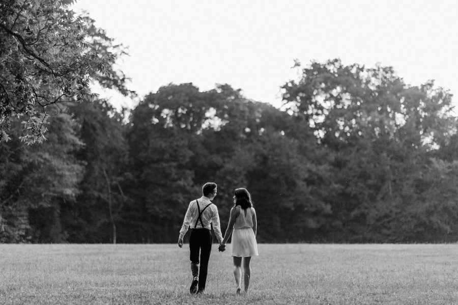 Couple walking in field in Charlotte NC