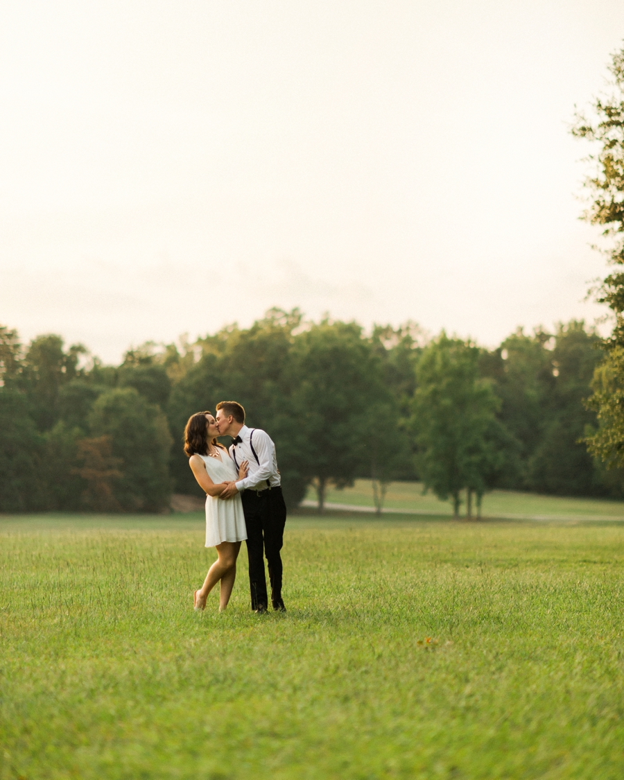 Couple embracing in field in Charlotte NC