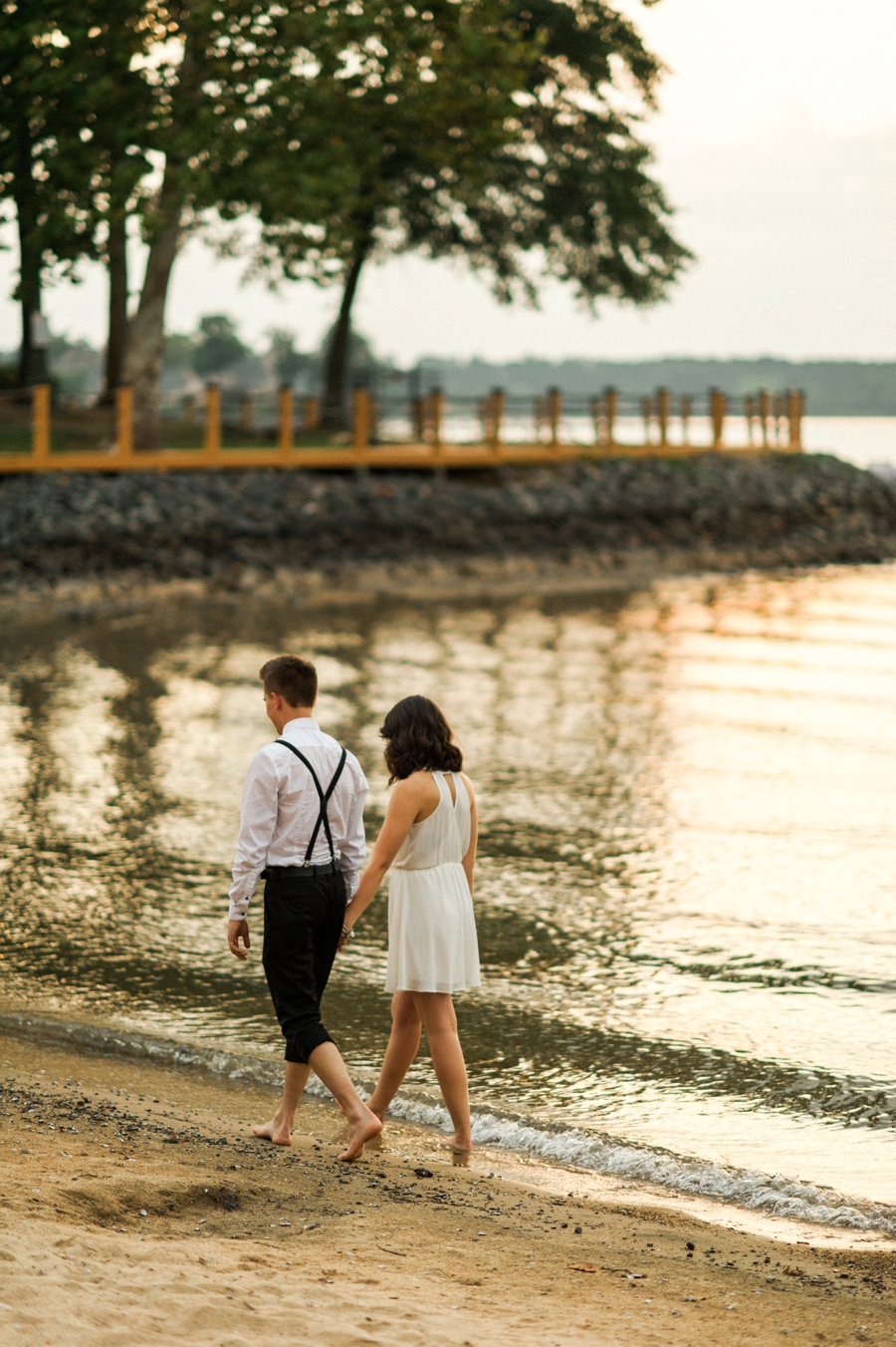 Couple walking on the shores of Lake Wylie in Charlotte NC