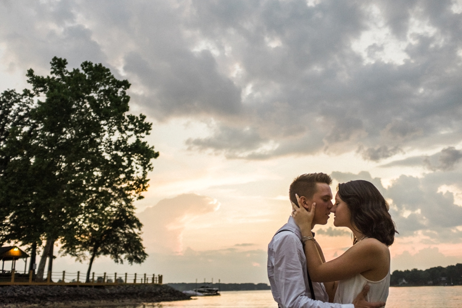 Couple embraces on the shores of Lake Wylie in Charlotte NC