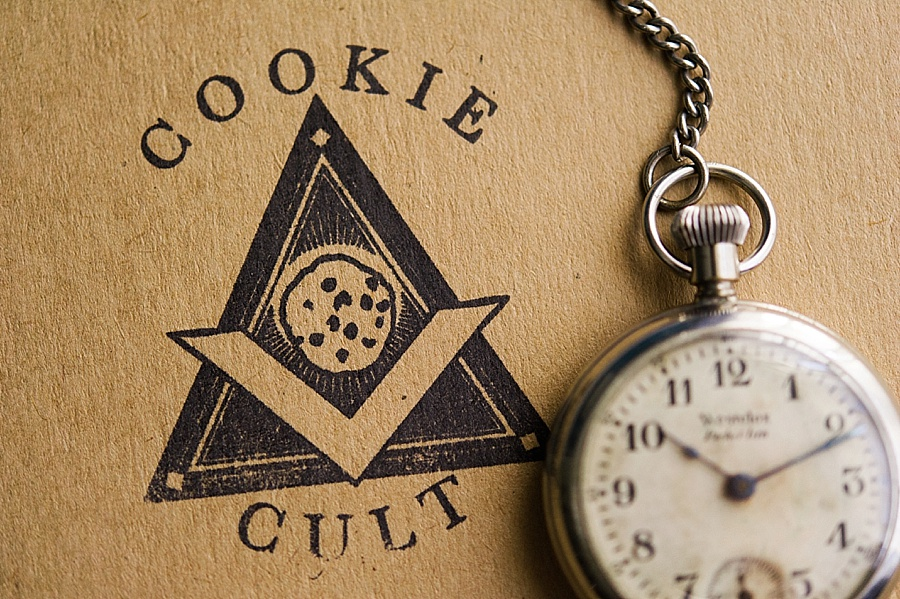 The Cookie Cult box with a pocket watch in Charlotte NC