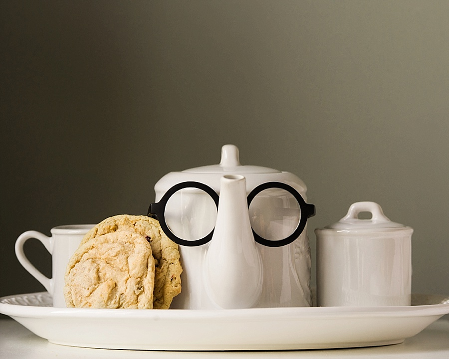A teapot with glasses on with  cookie and a sugar bowl for the Cookie Cult in Charlotte NC