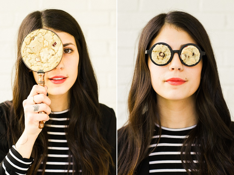 Woman with Cookie Magnify glass and cookie glass for The Cookie Cult in Charlotte NC