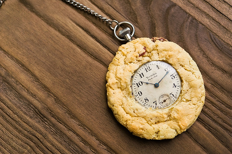 A pocket watch sitting in a cookie for The Cookie Cult in Charlotte NC