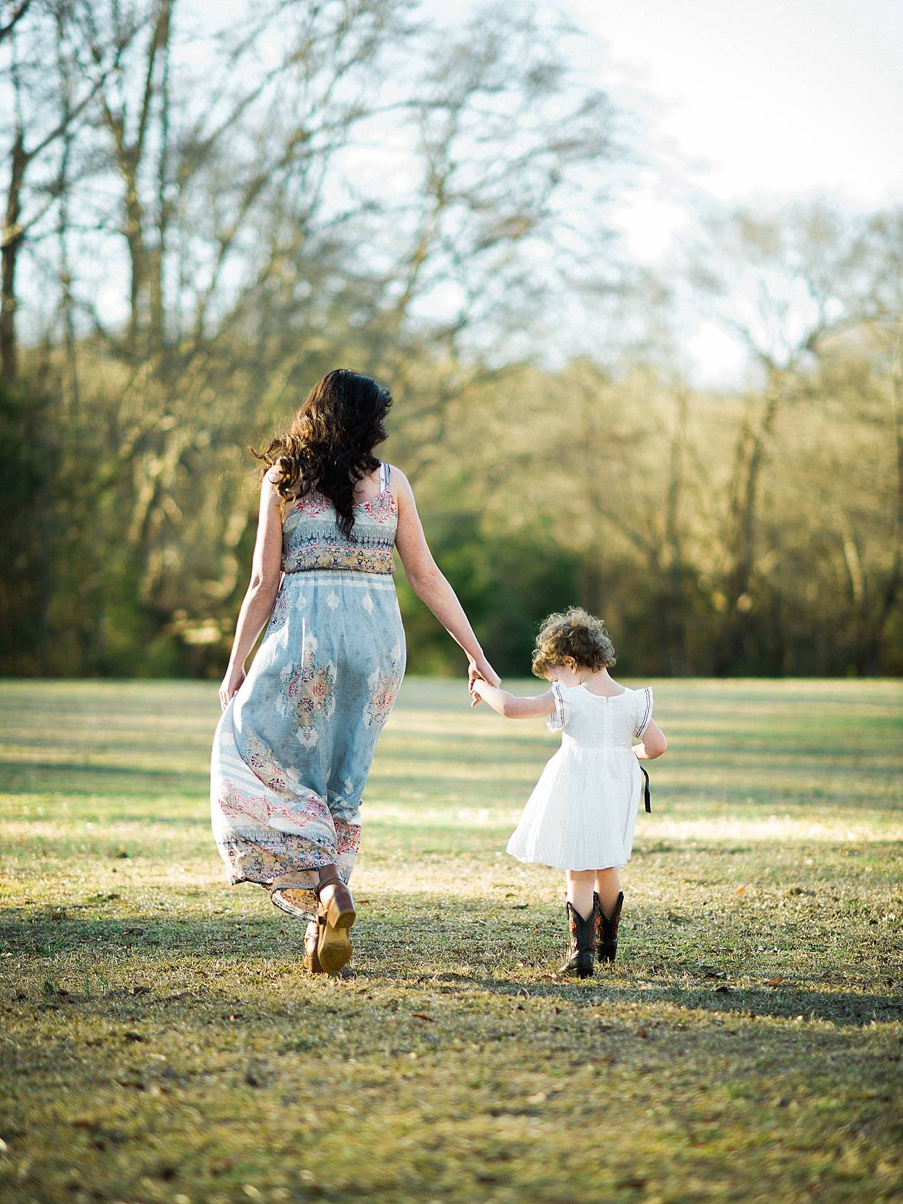 a mother and daughter walk hand in hand at Westminster Park, Rock Hill, SC