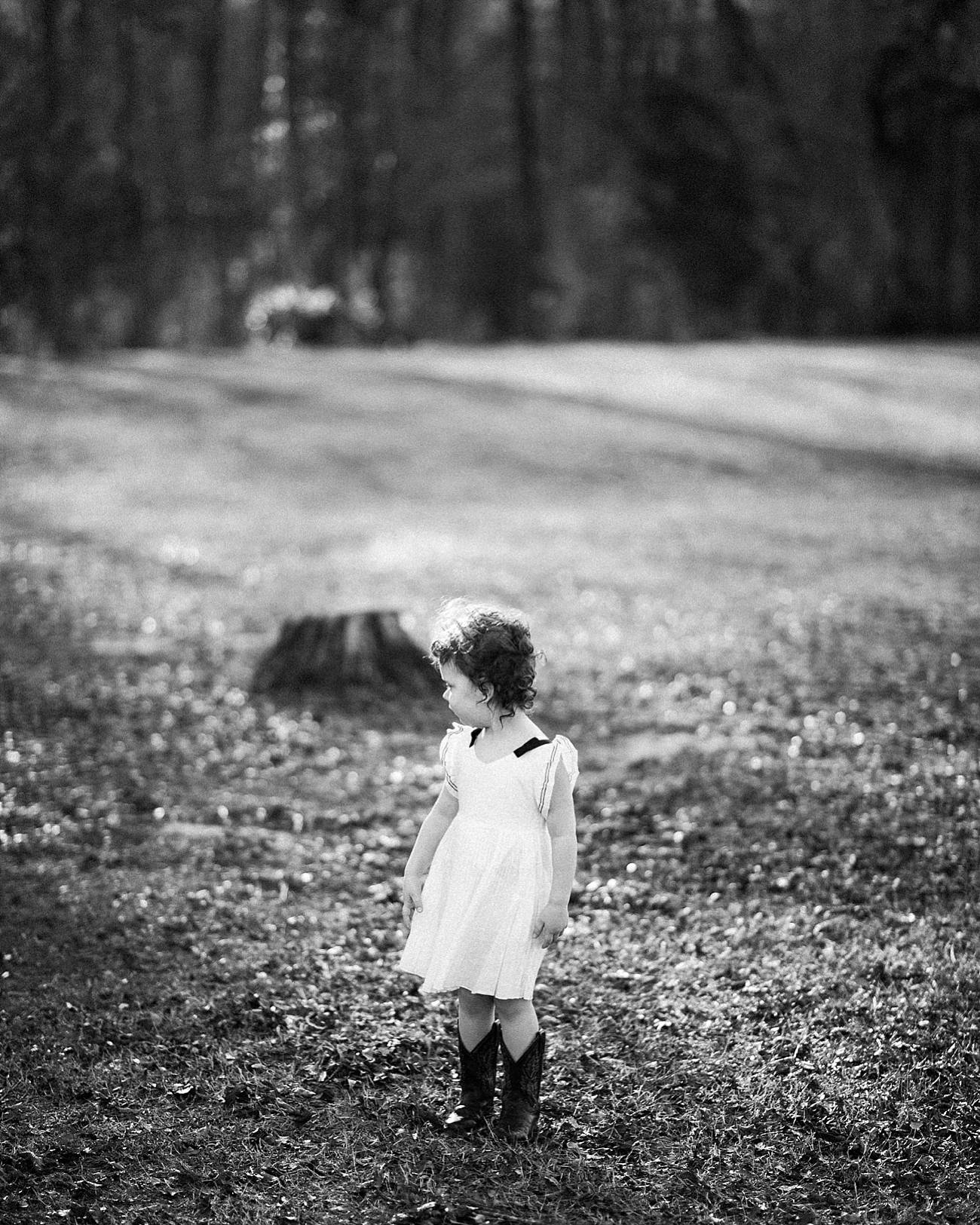 a little girl in a field at Westminster Park, Rock Hill, SC