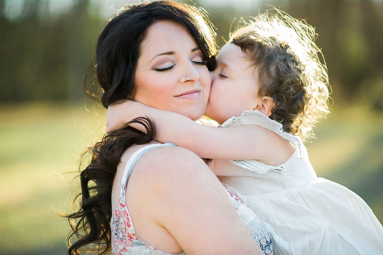 a little girl kisses her mother at Westminster Park, Rock Hill, SC
