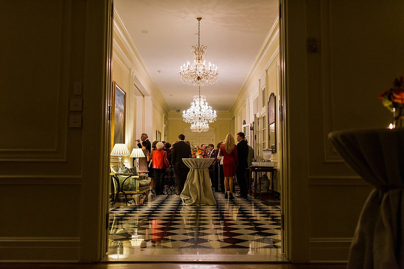 Guests mingle in the hallway of the Duke Mansion in Charlotte, NC