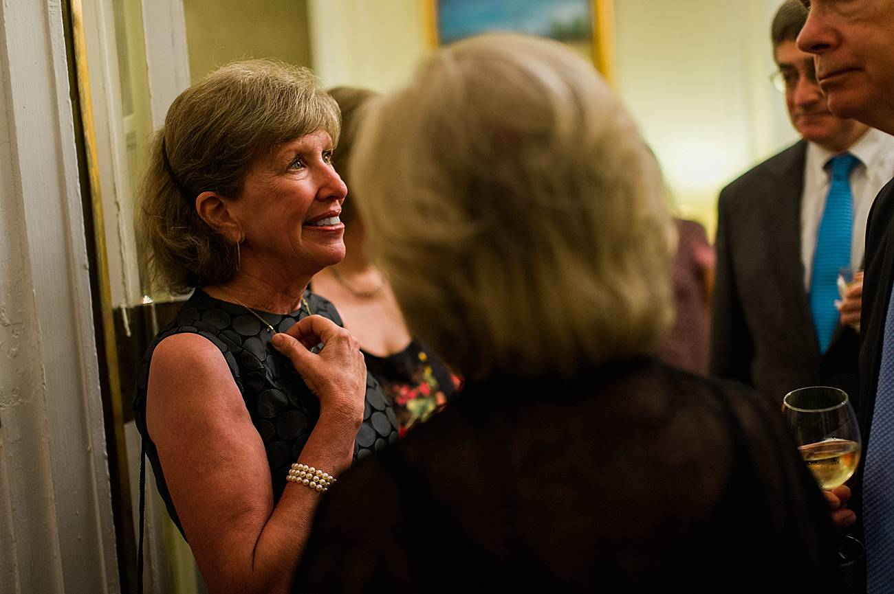 Guests smile while talking at the duke mansion in Charlotte, NC